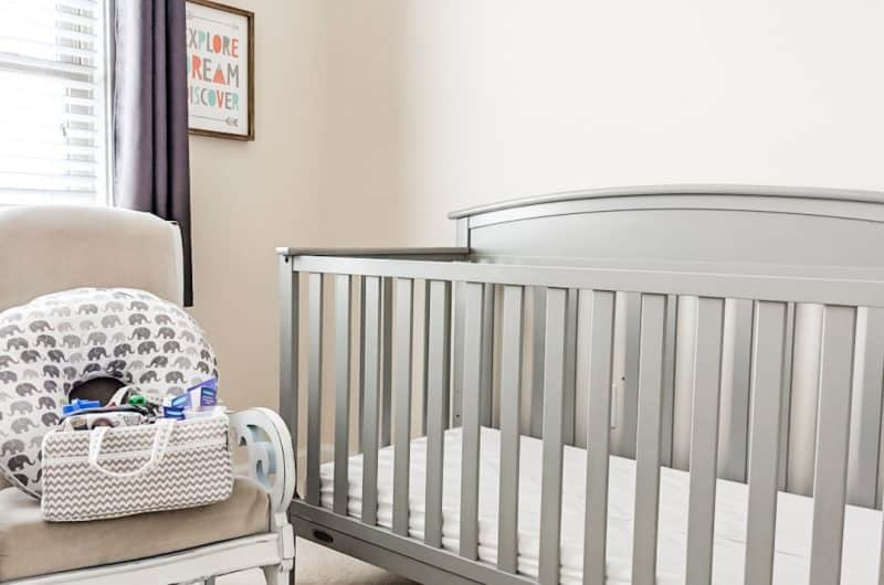 breastfeeding station in baby's nursery includes a nursing pillow and breastfeeding caddy with all the nursing essentials
