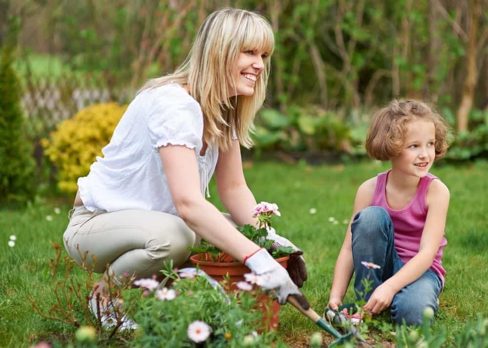 aunt and little girl gardening together