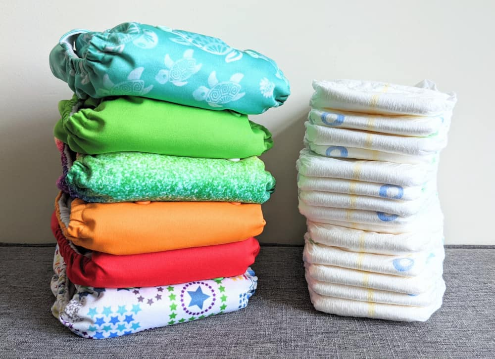 pile of cloth diapers and disposable diapers