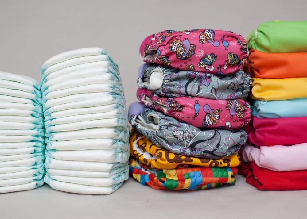 pile of disposable diapers and cloth diapers