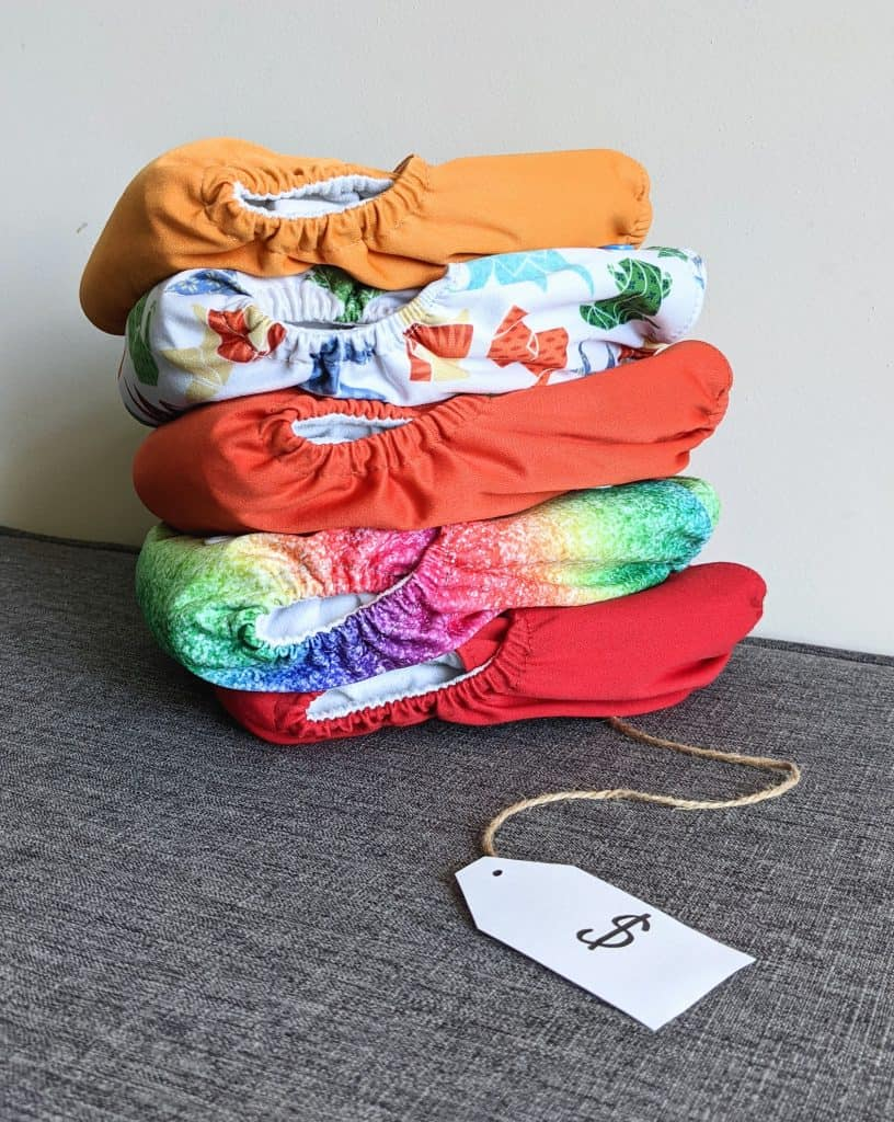 pile of cloth diapers with price tag