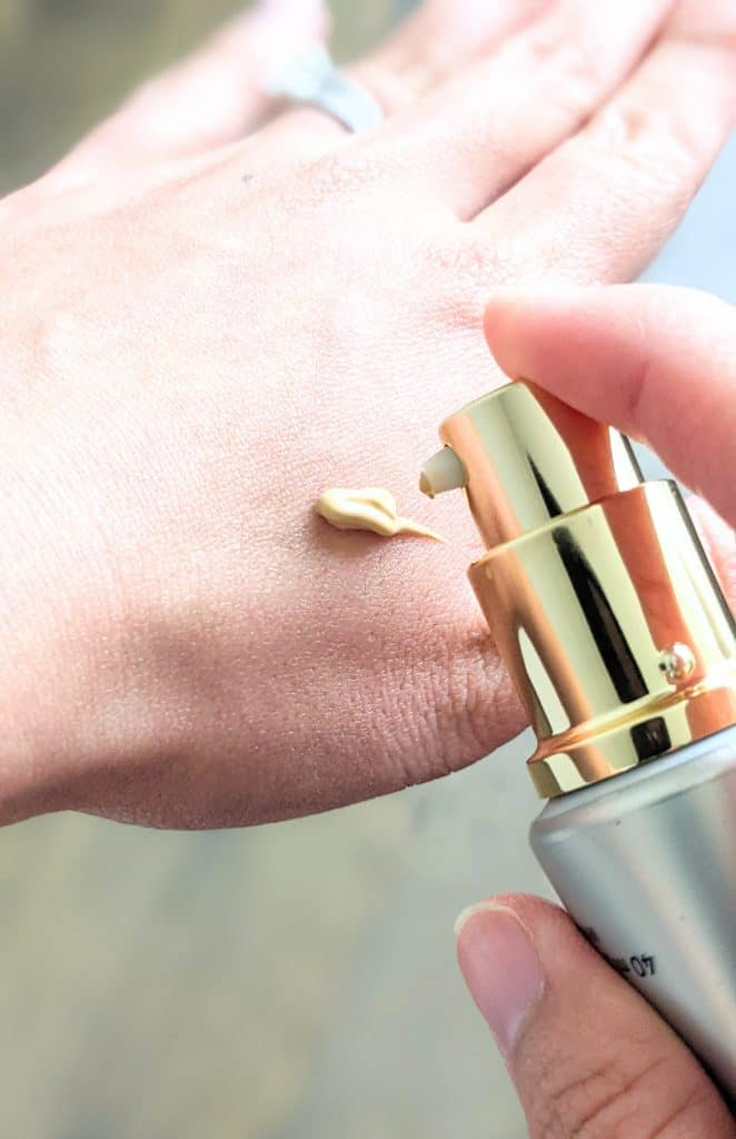 Beautycounter Flawless in Five Tinted Moisturizer in Light being applied to hand